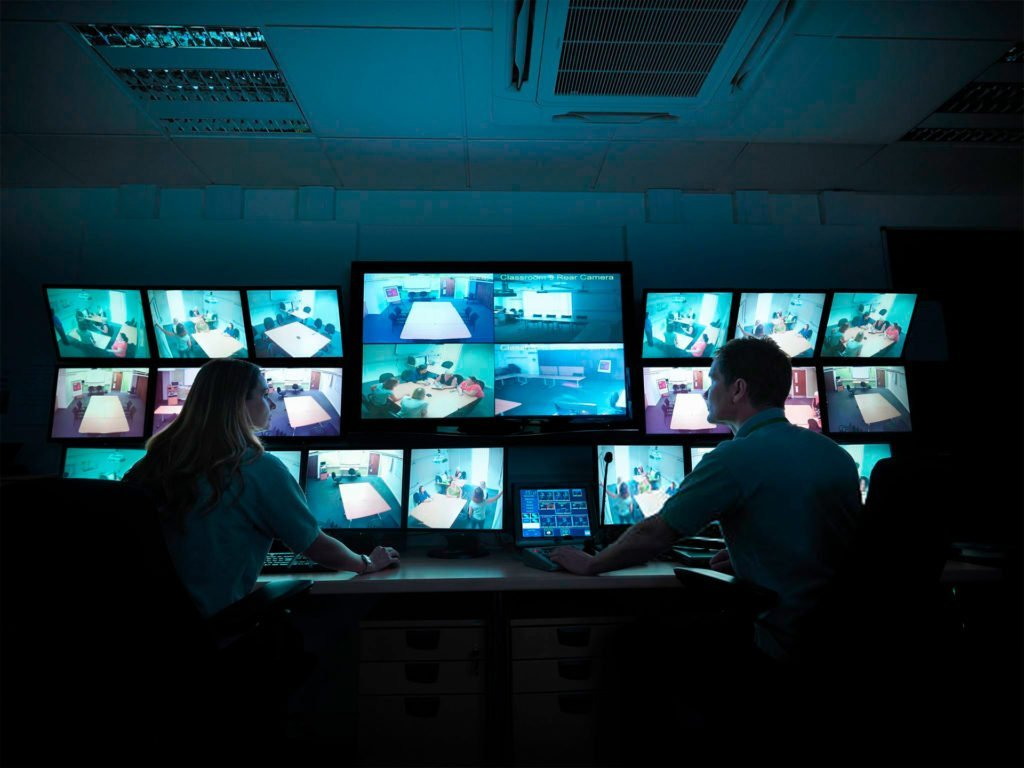 security team reviewing monitors