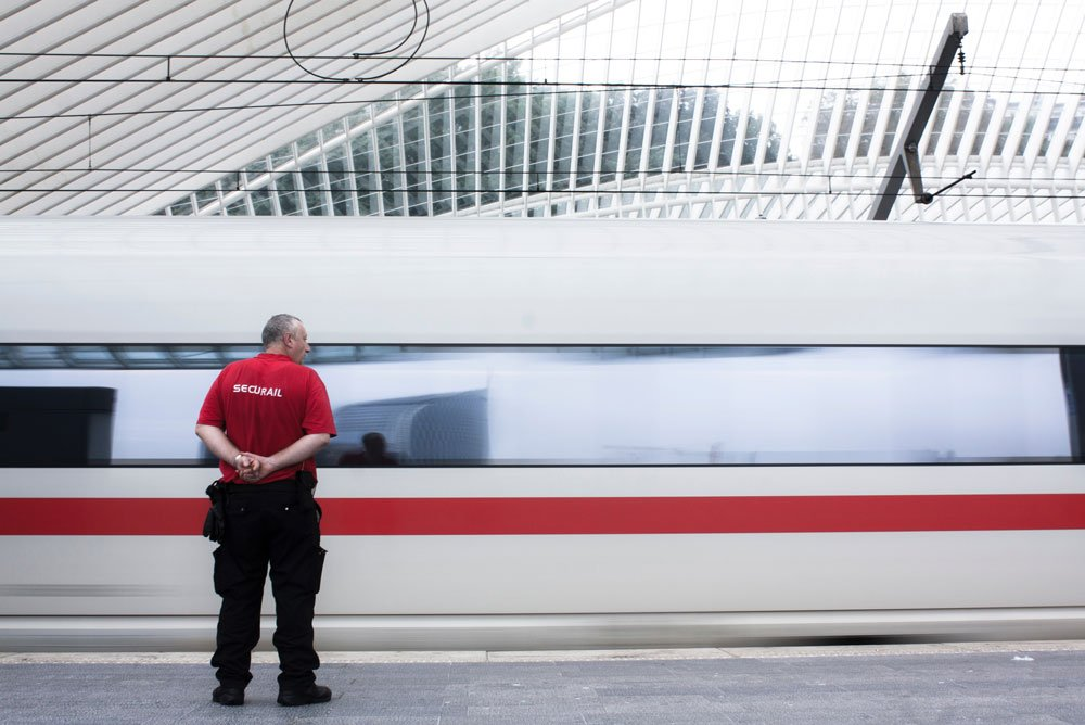 armed security guard on train platform