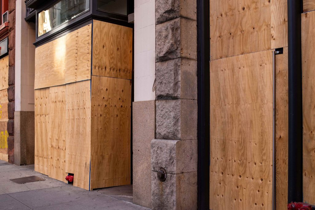 buildings boarded up due to riots