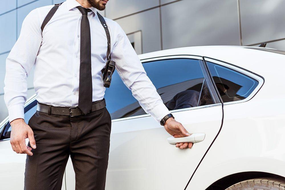 armed guard opening car door