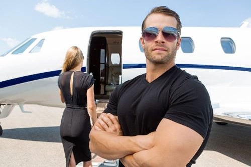 bodyguard outside private jet